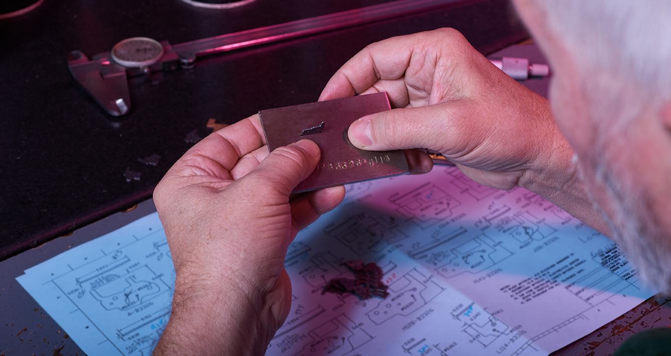 Employee's Hands Working With Metal Piece